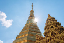 View Of The Top Of Golden Pagoda Of Wat Prathat Cho Hae With Sun Flare At Phrae Province, Thailand.