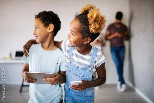 Fotografía Happy children havig fun and using technology devices