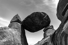 Low Angle Greyscale Shot Of A Large Boulder Balanced On Rocks In Grapevine Hills, Texas USA