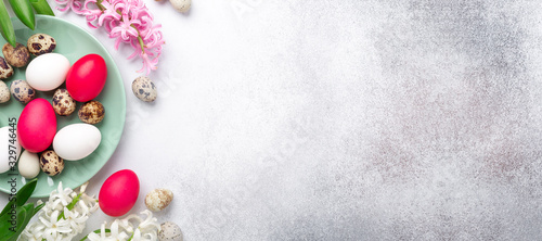 Obraz Easter composition. Green mint plate, easter eggs, pink and white hyacinth on stone background. Horizontal banner. Copy space for text - fototapety do salonu