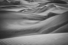 Greyscale Shot Of The Sandy Hi...
