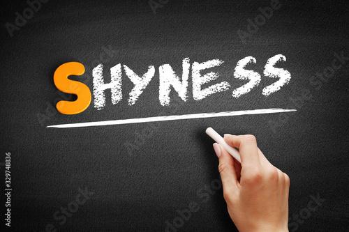 Vászonkép Shyness text on blackboard, concept background