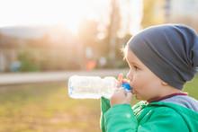 Beautiful Child Drinks Water F...