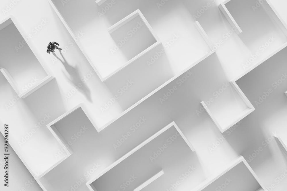 Fototapeta man walking in a complex white maze, surreal concept