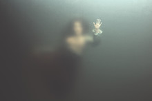 Siren Woman Swimming Underwater Behind Glass Surface, Surreal Concept