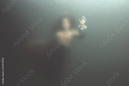 siren woman swimming underwater behind glass surface, surreal concept Canvas Print