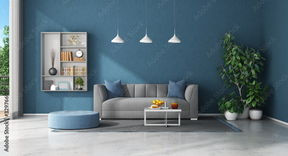 Fototapeta Blue living room with sofa and bookcase