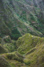 Vertiginous Mountains Ridge With Some Houses, Valleys And Peaks Covered With Yellow Grass And Green Mango Trees