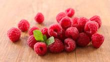 Raspberry Heap On Wood Backgro...