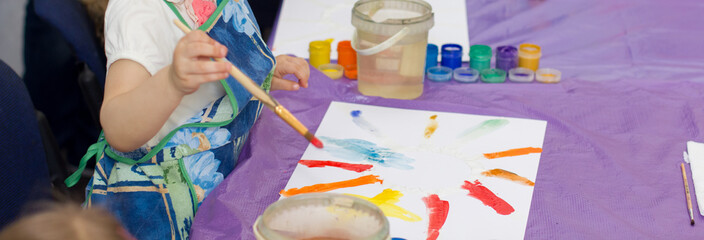 Children draw in watercolor