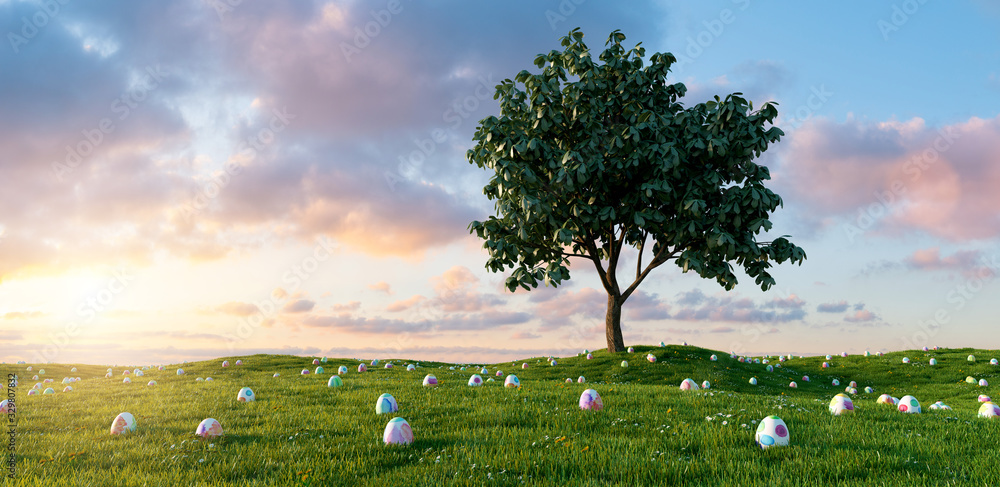 Fototapeta Many colorful Easter eggs lie in a meadow around a tree for Easter with dramtic sunset sky