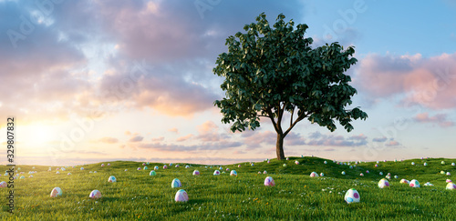 obraz lub plakat Many colorful Easter eggs lie in a meadow around a tree for Easter with dramtic sunset sky