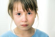 Closeup Portrait Of Sad Crying...