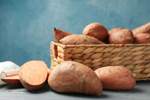 Sweet Potato In Basket On Wooden Table, Close Up