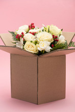 Bouquet Of Flowers In Carton Box On Pink Background