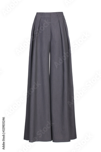 Fototapeta Grey women's wide classic trousers made of wool fabric isolated on white backgro