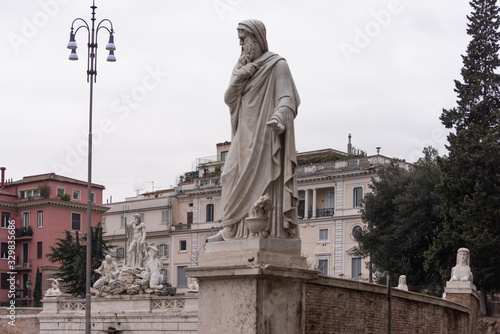 The statue of winter at Piazza del Popolo in Rome, Italy. Canvas Print