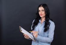 Office Woman With A Clipboard On A Black Background
