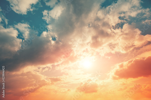 Fototapeta Colorful cloudy sky at sunset. The sun shines through the clouds. Color gradient. The texture of the sky. Abstract natural background obraz