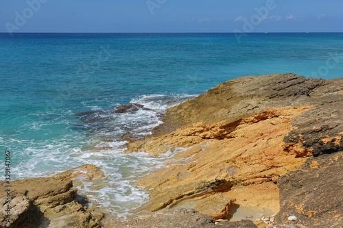 View of a beach on the blue Caribbean Sea in Saint Martin (Sint Maarten), Dutch Wallpaper Mural