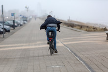 Bicycle Rider On A Path Over T...