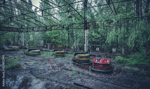 Broken metal radioactive cars in amusement park in Pripyat, the Chernobyl disast Canvas Print