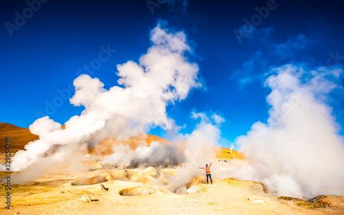 Slika na platnu Girl near huge steaming geysers in sunshine Bolivia