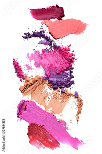 Creative beauty fashion concept photo of cosmetic products lipstick eyeshadows swatches on white background. Wall mural