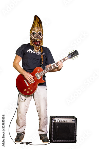Photo Man in mask of angry corn and casual clothing playing electric guitar isolated on white background
