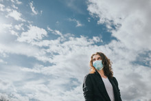 Woman Wearing Surgical Mask Ou...