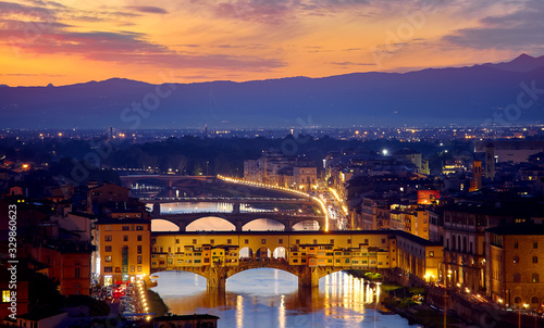 Evening sunset over Florence with Ponte Vecchio bridge on Arno river and tower in Italy Canvas Print