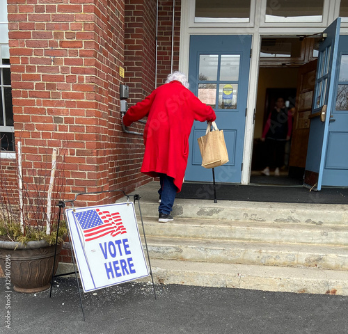 Fotografie, Tablou Old Woman Voter Entering Voting Polling Place for USA Government Election