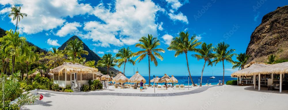 Fototapeta Sugar beach Saint Lucia , a public white tropical beach with palm trees and luxury beach chairs on the beach of the Island St Lucia Caribbean