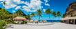 canvas print picture - Sugar beach Saint Lucia , a public white tropical beach with palm trees and luxury beach chairs on the beach of the Island St Lucia Caribbean