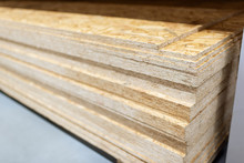 Stacked Chipboard Sheets In A Woodworking Industry. Stacks With Plywood. Chipboard Manufacturing Workshop. Timber For The Construction Of Frame Houses
