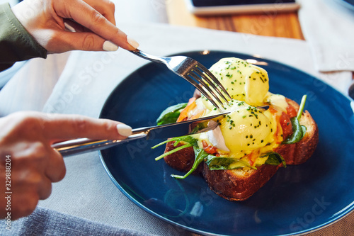 Benedict with pickled salmon and spinach on a blue plate Wallpaper Mural