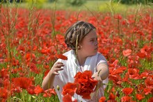 Girl Amidst Poppies On Field