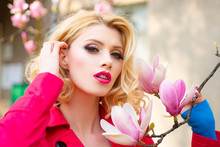 Spring Woman. Portrait Of A Beautiful Young Girl Holding Magnolia Flower. Spring Make-up