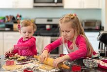 Two Cute Little Girls Rolling ...