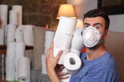 Cuadros en Lienzo Man hoarding toilet paper during pandemic