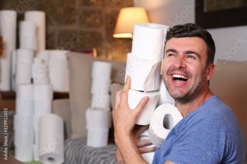 Man stocking up toilet paper at home - 329932655