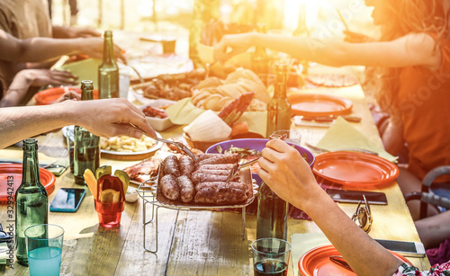 Obraz Midsection Of Friends Having Food During Garden Party - fototapety do salonu