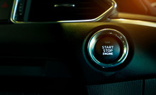 Start Stop Engine Button Of Luxury Car. Push Up Button For Start Or Stop Car Engine In Keyless Automobile. Turn Key With Ignition System Concept. Black Ignition Switch. Car Dashboard Interior View.