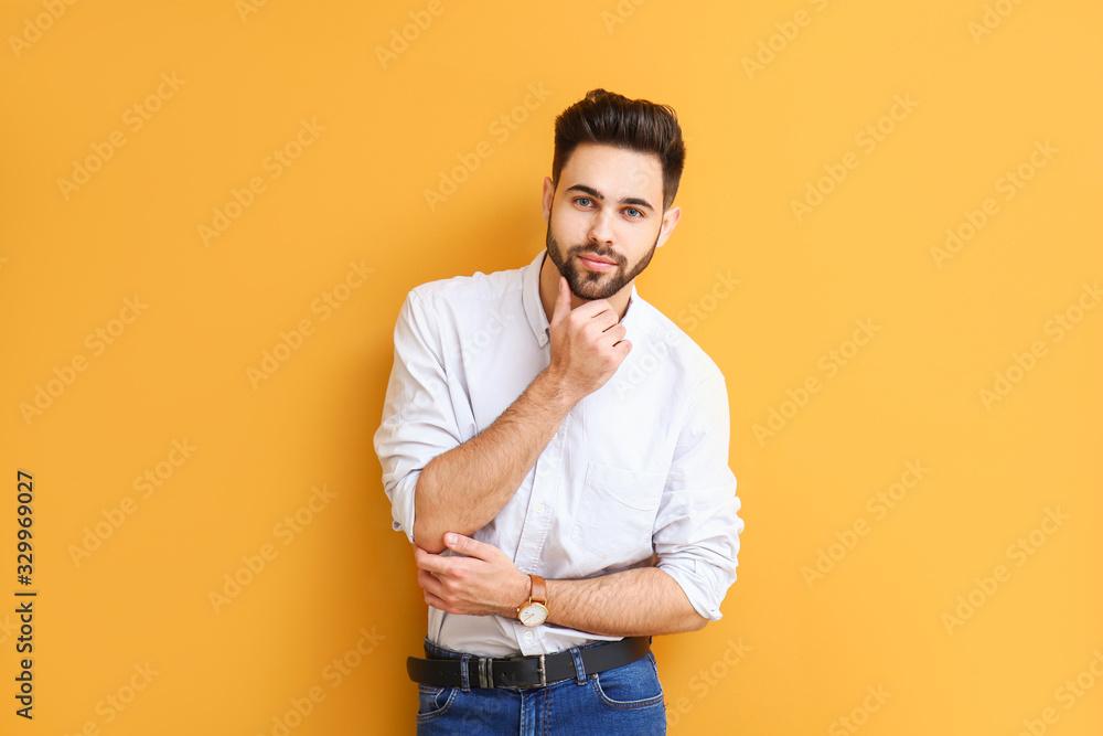 Fototapeta Handsome young man on color background