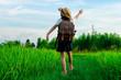 Girl Standing Of Agricultural Field Against Sky