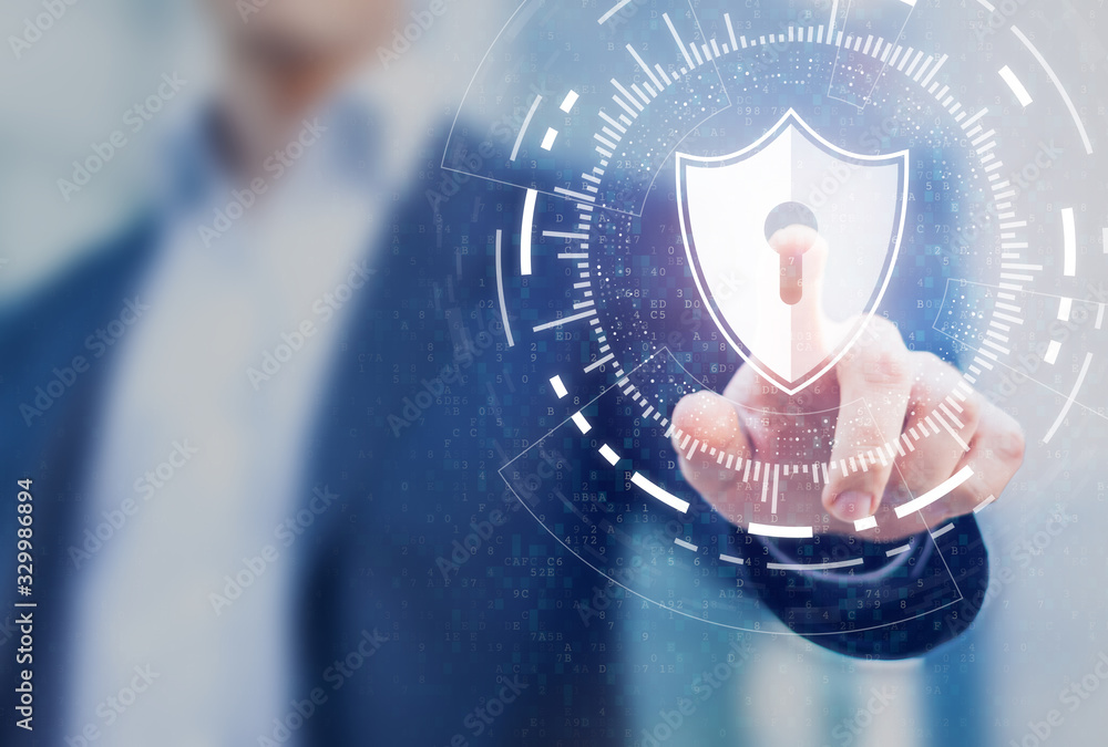 Fototapeta Cybersecurity of digital network systems with computer security engineer touching shield icon. Information technology protected with firewall, secure access and encryption against cyber attacks
