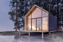 Secluded Tiny House On The Sandy Shore Of A Lake With Fog In A Coniferous Forest In Cold Cloudy Lighting With Warm Light From The Windows. Stock 3D Illustration