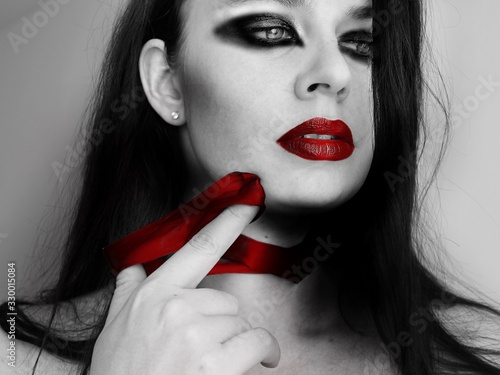 Close-up Of Woman With Eye Make-up And Red Lipstick