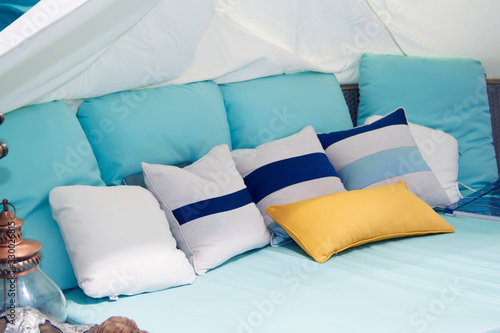 Close-up of a new mint-colored blanket with decorative pillows, mint headboard i Wallpaper Mural