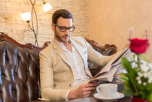 Handsome Businessman Reading N...